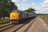 On summer Saturdays in 2015, Norwich-Yarmouth services included this heavyweight formation of two Class 37s (37405 plus 37425) and three carriages shuttling backwards and forwards via Reedham. The ratio of genuine passengers to enthusiasts on these trains is an interesting topic for speculation. This photo shows the ensemble roaring back to Norwich through Buckenham station on July 18th.<br><br>[Mark Dufton&nbsp;18/07/2015]
