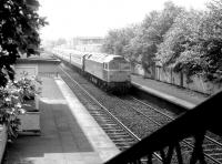 A class 47 hauled train passing east through Slateford station on its way to Waverley in May 1981, prior to demolition of the old station buildings. The train is the Edinburgh portion of a down WCML service which had been split at Carstairs. <br><br>[John Furnevel&nbsp;07/05/1981]