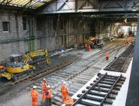 Replacing the crossover on the north side of Waverley in March 2006 prior to commencing construction of the new Balmoral through platform. View is east towards the temporary access created from Calton Road to bring in plant and materials. [See image 7435] <br><br>[John Furnevel&nbsp;26/03/2006]