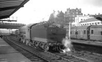Gresley V2 2-6-2 no 60913 waiting for a train at Carlisle on 1 February 1964. The train in question is 9.25am Crewe - Perth. [See image 30719]<br><br>[K A Gray&nbsp;01/02/1964]