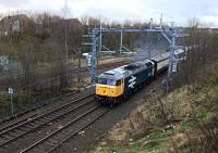 An unidentified  electric multiple unit, sandwiched between two translator coaches, is hauled by 47805 up the gradient towards  Eastfield on 23rd December 2015.<br><br>[Colin McDonald&nbsp;23/12/2015]