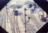 The East Lancashire platforms at Preston station, viewed through the lattice work of Vicars Bridge in 1964. 2-6-4T 42187 is probably running round a Southport service, which would be withdrawn a few weeks later. The goods depot is on the right. The East Lancashire platforms survived until the 1972 electrification remodelling. [See image 18734] for a modern day comparison. Photo from Cam Camwell collection - photographer unknown.  <br><br>[W A Camwell Collection (Courtesy Mark Bartlett)&nbsp;28/07/1964]