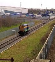 It's a lonely life a-shunting. Malcolm group locomotive 08823 returns to the main yard at DIRFT on 18 December 2015 after depositing a rake of Cargowaggons by the Eddie Stobart warehouse [see image 53111]. The Northampton loop off the WCML is out of view to the right of the concrete fence.<br><br>[Ken Strachan&nbsp;18/12/2015]