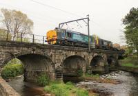 DRS 37606 and 20308, and three flask wagons, cross the River Wyre at Scorton heading for Sellafield on 22nd May 2015. The innocuous looking Wyre would later cause severe problems when it flooded and breached further down stream in December 2015.<br><br>[Mark Bartlett&nbsp;22/05/2015]