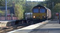 6G08 Hunterston - Longannet loaded coal hoppers passing through Coatbridge Central on 29 September 2015. DBS class 66 No 66165 is in charge.<br><br>[Ken Browne&nbsp;29/09/2015]