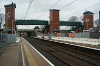 A view north towards Preston along platform 1 at Leyland on 26 December 2015 with the new footbridge in place and the three lift shafts now dominating the skyline. <br><br>[John McIntyre&nbsp;26/12/2015]