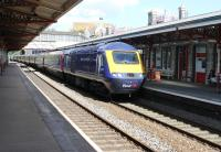 First Great Western 43015 speeds through Teignmouth at the head of a Paddington to Penzance express on 29th July 2015. <br><br>[Mark Bartlett&nbsp;29/07/2015]