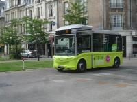 One of the electric midi buses operating a free shuttle service, Sundays excepted, around the centre of Reims, between the station and the Cathedral. The bus is crossing the tracks of the Reims tramway by the south end of Langlet tram stop.<br><br>[David Pesterfield&nbsp;24/07/2015]