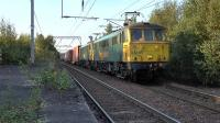 Freightliner class 86s No 86605+86638 work 4M11 from Coatbridge FLT - Crewe Basford Hall through Coatbridge Central station on 29th September 2015.<br><br>[Ken Browne&nbsp;29/09/2015]