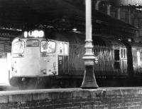 A cross platform shot of 5411 waiting to leave Waverley on the evening of 10 October 1972 on the west end of a push-pull shuttle service to Glasgow Queen Street. [See image 4642]<br><br>[John Furnevel&nbsp;10/10/1972]