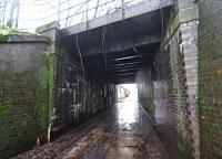 The bridge over the minor road to the north of St Boswells station originally carried two tracks and was extended on the east side as the goods yard, serving a large market, expanded. The view looks west.<br><br>[Ewan Crawford&nbsp;26/12/2015]