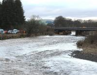 Some of the considerable activity taking place on and around the WCML viaduct at Lamington on the morning of 2 January 2016. Part of the structure has suffered due to the effects of recent heavy rainfall on the fast-flowing River Clyde during storm <I>Frank</I>. At the time of the photograph (1030) the rain had stopped, although surrounding roads and fields were saturated, with flooding apparent in several areas. The line will be closed for some time. [See image 54263]<br><br>[John Furnevel&nbsp;02/01/2016]