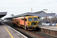 Colas Rail <I>Plasser & Theurer</I> Switch & Crossing Tamper machine DR73935 passing through Didcot station on 23rd December 2015.<br><br>[Peter Todd 23/12/2015]
