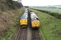English Electric Type 3s meet at Ropley on the Mid-Hants Railway. Split headcode 37324 'Clydebridge' on passenger train duties passes 37901 in the siding on 28th December 2015. <br><br>[Peter Todd&nbsp;28/12/2015]