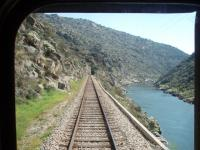 The view from the rear corridor connection door of a Pocinho to Porto service as it heads down the Douro Valley near Alegria in March 2008. This view taken in the valley below the river dam. [See image 18539] for the lineside view above that structure.<br><br>[Mark Bartlett&nbsp;20/03/2008]