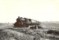 A train from St Combs photographed approximately 2 miles south of Fraserburgh on 5 August 1953. Ivatt 2-6-0 46460 is crossing the bridge over the Water of Philorth shortly after restarting from Philorth Bridge Halt. [See image 48605]<br><br>[G. H. Robin collection by courtesy of the Mitchell Library, Glasgow.&nbsp;05/08/1953]