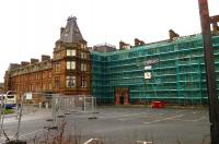 Barriers and scaffolding around Ayr's Station Hotel in January 2016. Built by the GSWR in 1866, the grade 2 listed building, which forms an integral part of Ayr station, closed in 2013, since when it has begun to show considerable signs of neglect. The current activity is the result of a dangerous buildings notice served on the current owners by South Ayrshire Council.<br><br>[Colin Miller&nbsp;05/01/2016]