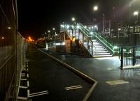 Another planned opening date, of 21st December 2015, has passed by Bermuda Park station and its counterpart at Ricoh Arena. The problems with the signal on the platform at Ricoh are well documented, but a new dispute has arisen at Bermuda. As shown, there are currently only ten parking spaces, in all of which your car is in danger of being struck by passing HGV's. The railway wants to take over the car park of a former distribution centre, but the local MP wants the distribution centre re-opened to provide 'local jobs for local people'. You can see his point - especially if the workers arrive by train! View looks North towards Nuneaton station.<br><br>[Ken Strachan 21/12/2015]