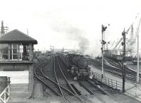 Corkerhill Black 5 45007 about to pass Ardrossan Harbour signal box on 6 July 1959 with a Winton Pier - St Enoch express.<br><br>[G H Robin collection by courtesy of the Mitchell Library, Glasgow&nbsp;06/07/1959]