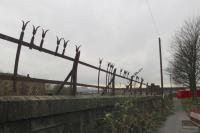 Remains of Caledonian Railway security fencing atop the wall of the former goods depot. No need for CCTV, just seek out the individual with 'life-changing injuries'.<br><br>[Colin Miller&nbsp;05/01/2016]