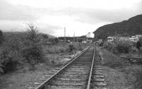View south at Aviemore on the Grantown line in June 1973. The PW gang is removing the ballast around the sleepers in preparation for the installation of a set of points, one of the first activities at Aviemore by the Strathspey Railway. The main line and Aviemore SB can be seen in the right background.<br><br>[John McIntyre&nbsp;/06/1973]