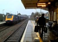 A hundred passengers leave, one arrives. An up HST heads South West, while passengers seated and walking await the Great Malvern DMU service. [See image 53799]<br><br>[Ken Strachan&nbsp;02/01/2016]