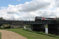 Seen from the grounds of the National Memorial Arboretum, a Cross Country Class 170 DMU crosses the River Tame heading north towards Burton-upon-Trent. <br><br>[Mark Bartlett&nbsp;28/08/2015]