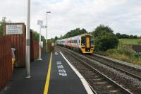 FGW 158798, on a Warminster to Westbury working, slows for the stop at Dilton Marsh Halt. The platforms here are staggered either side of the road bridge and this view, taken from the bottom of the ramp, illustrates just how short they are. [See image 52174]<br><br>[Mark Bartlett&nbsp;25/07/2015]