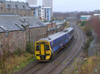 158701, after passing the closed Duddingston and Craigmillar station,  passes the former rail-served breweries.<br><br>[Bill Roberton