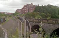 1988 view from the girder bridge of the Dumbarton - Balornock line showing the stone arch viaduct of the line from Glasgow Central Low Level with the junction in the left background. [See image 10342].<br><br>[Ewan Crawford&nbsp;//1988]