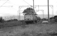 Glasgow Blue Train unit 041 approaching Cardross in 1974 with a Helensburgh to Bridgeton service.<br><br>[John McIntyre&nbsp;/04/1974]