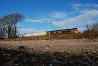 In gloriously sunny conditions, and just east of Ardmore level crossing, 66733 passes east with the empties from the Lochaber Smelter for North Blyth. [See image 53913] for the same locomotive working in the reverse direction the next day.<br><br>[Ewan Crawford&nbsp;15/01/2016]