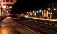 The diverted Caledonian Sleeper heads south through Kilmarnock on 10 January 2016 hauled by GBRf class 47s 47843+47848. The 47s will be replaced by a single class 90 electric locomotive at Carlisle.<br><br>[Ken Browne&nbsp;10/01/2016]