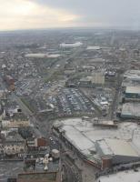 Blackpool Central station site as seen from the Tower in January 2016. It is over fifty years since it closed in 1964 but, from above, the former railway land can still be identified. The white building in the foreground is Coral Island, which occupies the site of the old terminus building. The car parks are laid over the fourteen platforms and the M55 link road goes south along the old formation through Bloomfield Road towards the still open Blackpool South. The tall red brick building at the far left of the car park is the old railwaymen's lodging house, now holiday flats. <br><br>[Mark Bartlett 16/01/2016]
