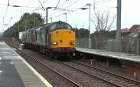 DRS 37609+37607 working the diverted 6M22 south through Barassie from Hunterston LL to Sellafield on 7 January 2016. This train normally runs via Kilwinning<br><br>[Ken Browne&nbsp;07/01/2016]