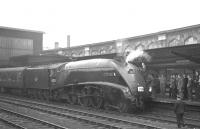 The RCTS (West Riding Branch) 'Three Summit Rail Tour' stands at Carlisle platform 4 on 30 June 1963 on its way home to Leeds City. A4 60023 <I>Golden Eagle</I> has taken over from classmate 60004 <I>William Whitelaw</I>, which had brought the special south from Auchinleck. The train returned to Leeds via the Low Gill - Sedbergh - Clapham route.<br><br>[K A Gray&nbsp;30/06/1963]