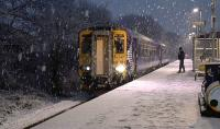 156513 works the 1A17 Kilmarnock to Glasgow Central service in very wintry conditions through Kilmaurs on 8 January 2016. This service has since been temporarily suspended and replaced by Virgin Voyagers until the bridge over the Clyde at Lamington is reopened in February.<br><br>[Ken Browne&nbsp;08/01/2016]