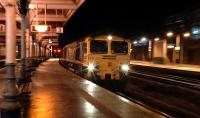 Freightliner 66517 heads the diverted 4L89 Coatbridge - Felixstowe containers through Kilmarnock station on 16 January 2016. This service is normally routed via Kilwinning.<br><br>[Ken Browne&nbsp;16/01/2016]