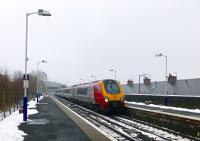 A displaced northbound Voyager passes at speed. A local expert (a bloke on the station) commented that he had not seen any 'dragged' Pendolinos, only Voyagers.<br><br>[Colin Miller&nbsp;18/01/2016]