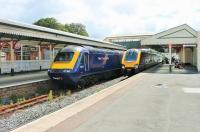 FGW HST power car 43152 and Cross Country Voyager 220026 stand in the main line platforms at Paignton awaiting departure time. Queen's Park station, for the Kingswear steam trains, is beyond the white picket fence. <br><br>[Mark Bartlett&nbsp;28/07/2015]