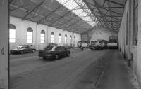 The 3'6' gauge Rothesay Tramway closed in 1936, but the Pointhouse depot survives in commercial use. Looking into the depot with rails in situ.<br><br>[Bill Roberton&nbsp;/10/1996]
