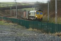 A Daventry to Coatbridge Freightliner container train rounds the curve between Grayrigg loops and Low Gill in the early afternoon of 23 January 2016.<br><br>[John McIntyre&nbsp;23/01/2016]