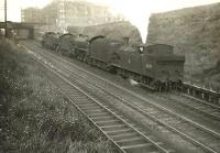 A locomotive quartet on its way from Eastfield shed to Queen Street station descending Cowlairs Incline on 6 September 1955. Leading is N15 69179, followed by B1s 61396 and 61134. Bringing up the rear is D49 62716 <I>Kincardineshire</I>. The first three are residents of 65A, while the D49 is a visitor from Thornton Junction.<br><br>[G H Robin collection by courtesy of the Mitchell Library, Glasgow&nbsp;06/09/1955]