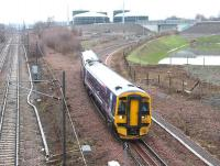A 158 DMU approaching Newcraighall North Junction on an overcast 19 January 2016. The train is the 1045 (Sunday) Tweedbank - Edinburgh Waverley.<br><br>[John Furnevel&nbsp;19/01/2016]