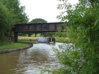Around half way between Middlewich and Northwich on the little used route linking the latter with Sandbach, the line crosses the Trent & Mersey Canal immediately beyond Whatcroft Lane overbridge. The long steel bridge over the canal is seen here in July 2015. [Ref query 4343]<br><br>[David Pesterfield&nbsp;16/07/2015]