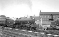 The south end of Doncaster on 31 May 1963, with Immingham B1 61056 at the head of a Cleethorpes – Sheffield Victoria relief service. In the background is EE Type 3 D6744, delivered new to Darnall shed just over a year earlier. 61056 was withdrawn from 40B the following May and cut up at the Central Wagon Works, Wigan, shortly thereafter. D6744 subsequently became 'Loadhaul' 37710 and was eventually obtained as a 'spares donor' by WCRC Carnforth in 2007 [see image 31684].<br><br>[K A Gray&nbsp;31/05/1963]