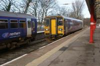 A Northern Class 153 arrives at Lancaster with a service from Morecambe on 30 January 2016. On the adjacent platform there were two Class 153s stabled between services.<br><br>[John McIntyre&nbsp;30/01/2016]