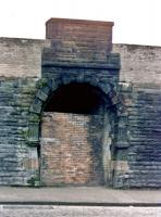 Riccarton & Craigie station entrance, close up showing decorative carving on the archway, 20 October, 1985, before the demolition men set to. There was still a short section of the island platform above at the time, located behind the red sandstone section of the wall above the arch, although the top of the stairs up from street level were buried.<br><br>[Robert Blane&nbsp;20/10/1985]