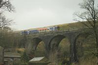 One mile north of the famous Ais Gill Summit, this less well known viaduct crosses the actual Ais Gill beck. 158784, on a Northern service from Carlisle to Skipton, passes over the bridge on the last stages of the climb on 1st February 2016.<br><br>[Mark Bartlett 01/02/2016]
