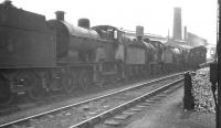 Shed scene at Nottingham (16A) on 13 May 1961. Amongst the locomotives awaiting disposal is class 2P 4-4-0 no 40557, withdrawn from here some 2 months earlier.  <br><br>[K A Gray&nbsp;13/05/1961]